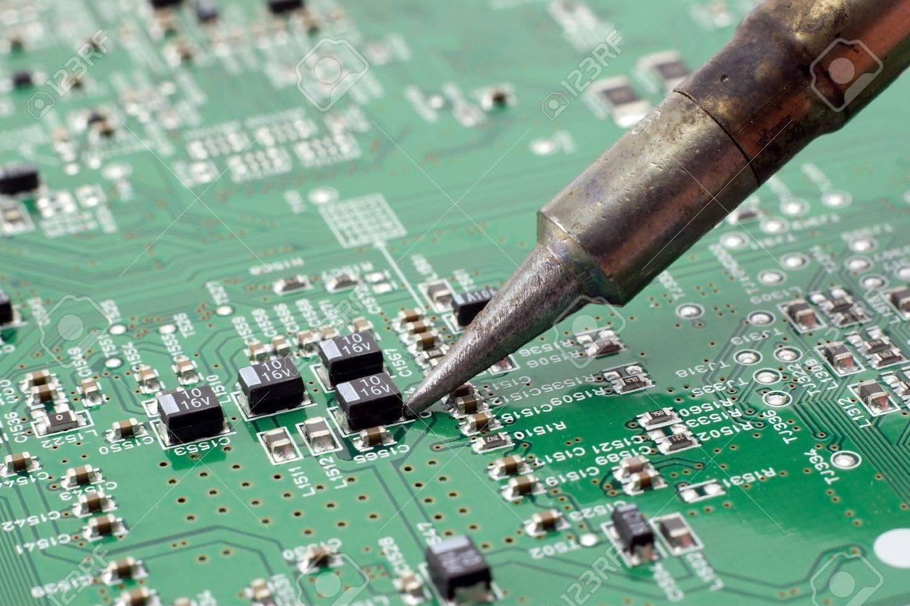 Sensational Technician Repairing Electronic Circuit Board With Soldering Stock Wiring Cloud Ittabisraaidewilluminateatxorg